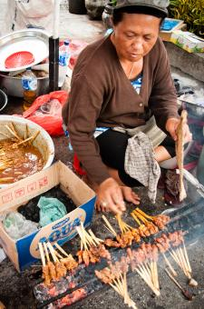 Free Stock Photo of Asian woman selling sate on the street