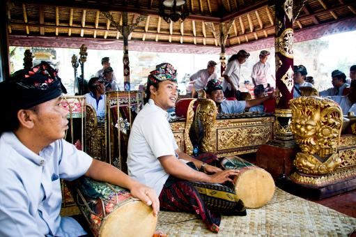 Free Stock Photo of Men play traditional gamelan percussion