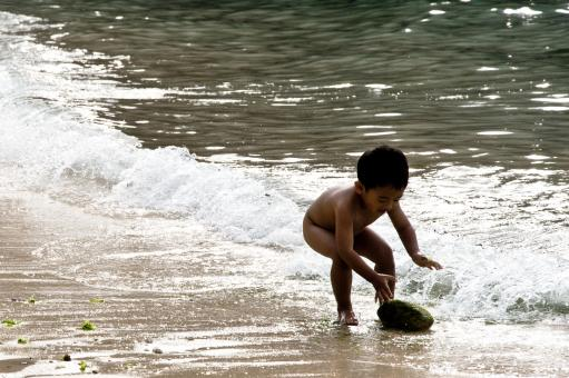 Free Stock Photo of Child playing in ocean