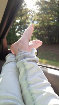 Free Stock Photo of Feet Out The Car Window