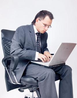 Free Stock Photo of Businessman using laptop