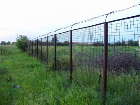 Free Stock Photo of Barbed wire fence near a private propert