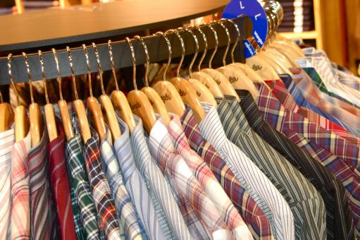Free Stock Photo of Men's Shirts Hanging on the Rack