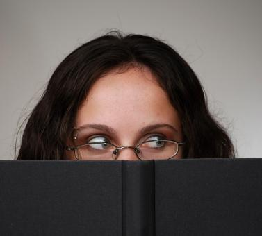 Free Stock Photo of Business woman looking over book