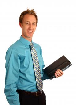 Free Stock Photo of A young businessman holding a binder