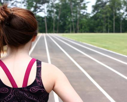Free Stock Photo of A cute young girl on a track field