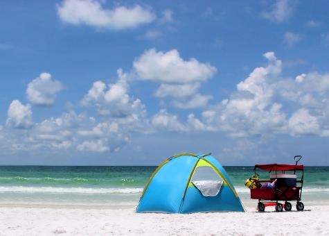 Free Stock Photo of A tent and buggy on a beach