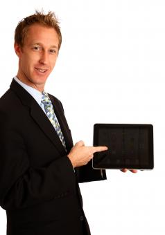Free Stock Photo of Businessman holding a tablet computer