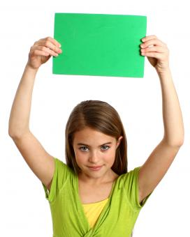 Free Stock Photo of Young girl holding a blank green sign