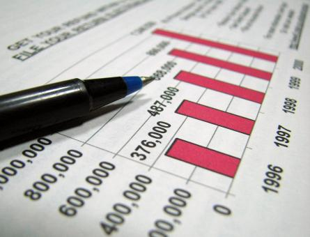 Free Stock Photo of Closeup of tax graph and pen