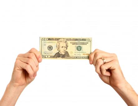 Free Stock Photo of Hands holding up a twenty dollar bill