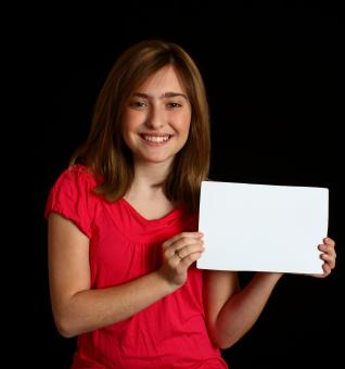 Free Stock Photo of A cute young girl holding a blank sign