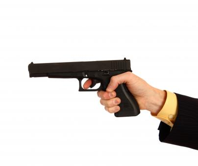 Free Stock Photo of Hand in a business suit holding a pistol