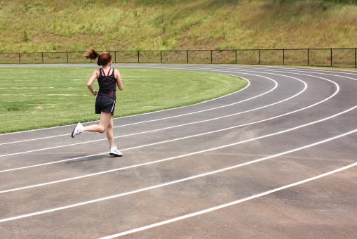 Free Stock Photo of A cute young girl running on a track