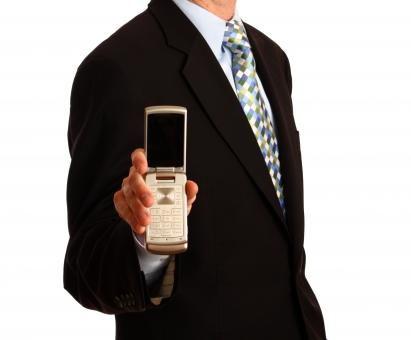 Free Stock Photo of A young businessman holding a cell phone