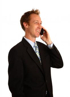 Free Stock Photo of A young businessman talking on a cell ph