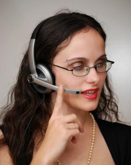 Free Stock Photo of Business woman talking on a headset