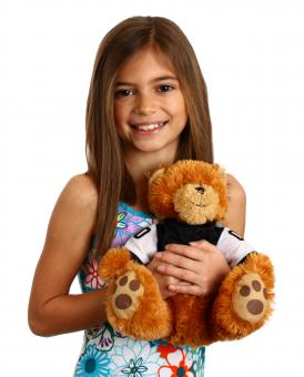 Free Stock Photo of A pretty young girl holding a teddy bear