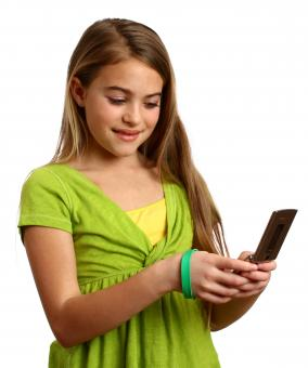 Free Stock Photo of A beautiful young girl texting on a cell