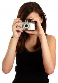 Free Stock Photo of A cute young girl taking a picture