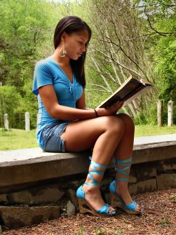 Free Stock Photo of A beautiful teen girl reading a book