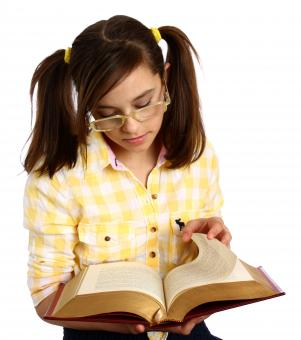 Free Stock Photo of A smart girl with glasses reading a book