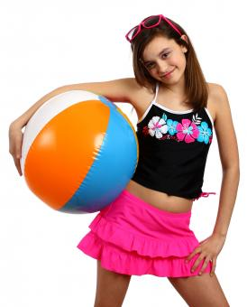 Free Stock Photo of A young girl posing with a beach ball