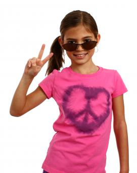 Free Stock Photo of A cute young girl making a peace symbol
