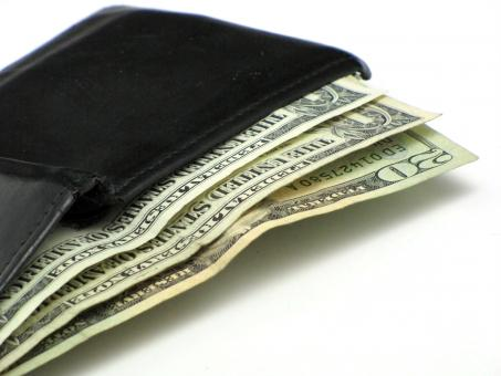 Free Stock Photo of Dollar bills in a black wallet