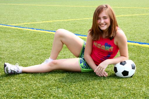 Free Stock Photo of A cute young girl posing with a soccer
