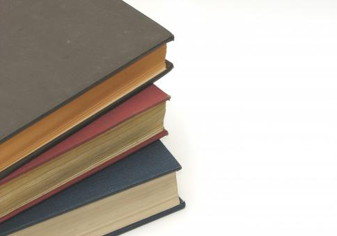 Free Stock Photo of A stack of books isolated on white