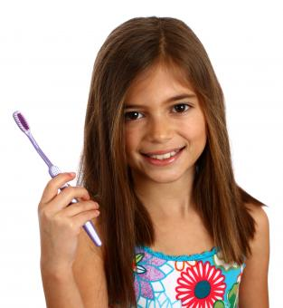 Free Stock Photo of A pretty young girl holding a toothbrush