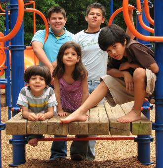 Free Stock Photo of A group of kids posing on a playground