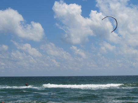 Free Stock Photo of A kitesurfer at sea