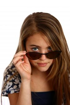 Free Stock Photo of Young girl posing with sunglasses