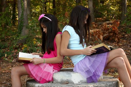 Free Stock Photo of Two cute young girls reading books