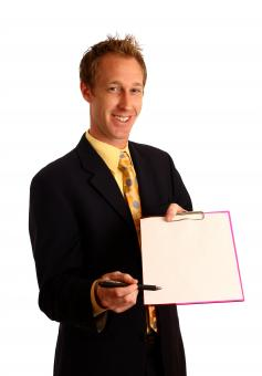 Free Stock Photo of Businessman holding a clipboard and pen