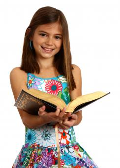 Free Stock Photo of A pretty young girl reading a book