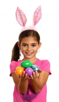 Free Stock Photo of A cute young girl holding Easter eggs
