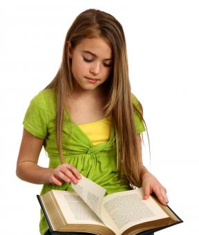 Free Stock Photo of A beautiful young girl reading a book