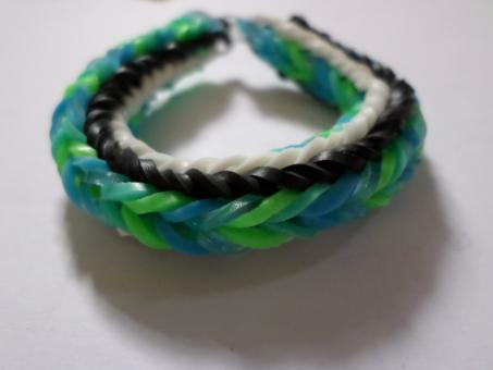 Free Stock Photo of Green, blue, black and white loom bracel