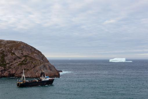 Free Stock Photo of Trawler and Iceberg at Sea