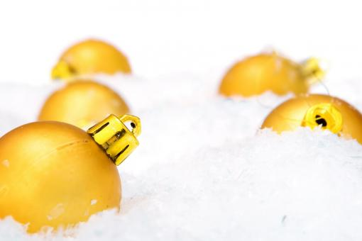 Free Stock Photo of Golden Christmas Baubles in Snow
