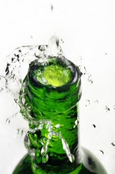 Free Stock Photo of Splashing Water from Green Bottle