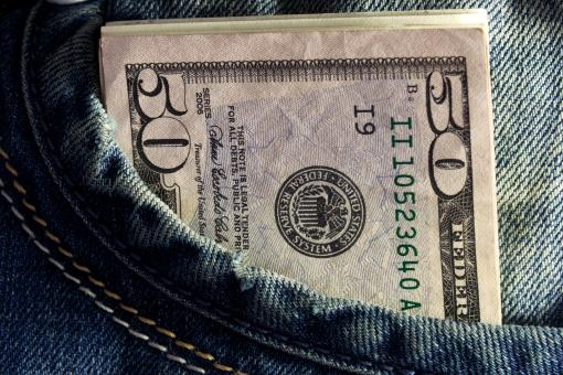 Free Stock Photo of US dollar in the Jeans Pocket
