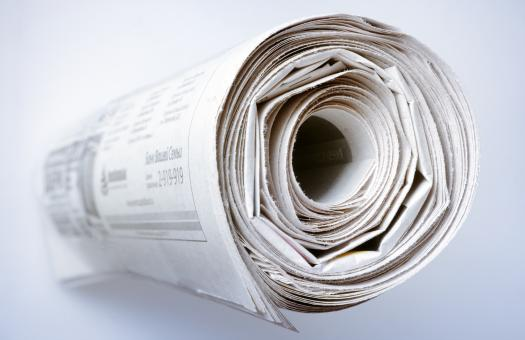 Free Stock Photo of Rolled up Newspaper
