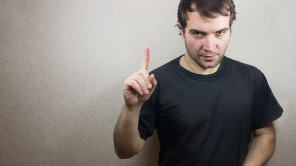 Free Stock Photo of Man holding his index finger up