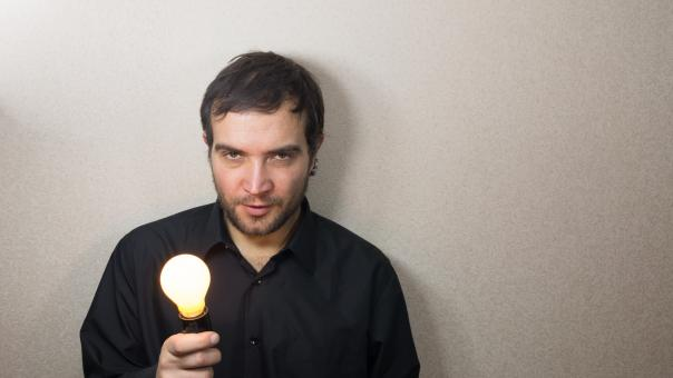 Free Stock Photo of Man holding light bulb