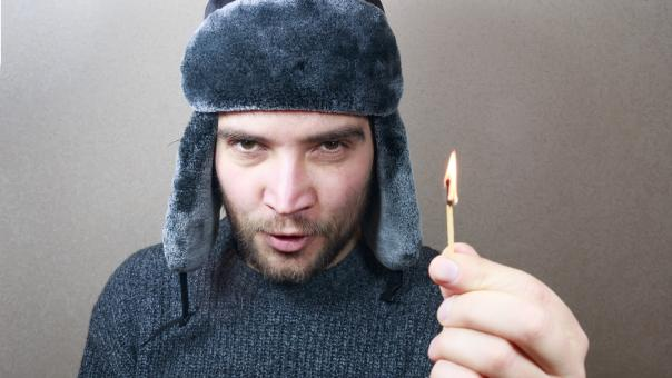 Free Stock Photo of Young man holding a match