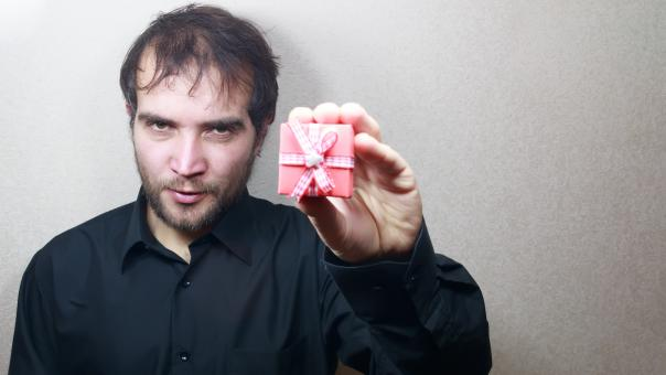 Free Stock Photo of Man holding a gift box